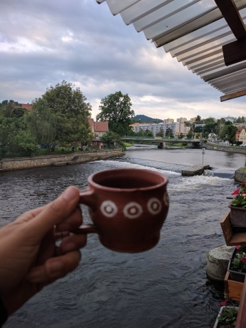 Skippy's view of the rapid from the terrace with her great coffee